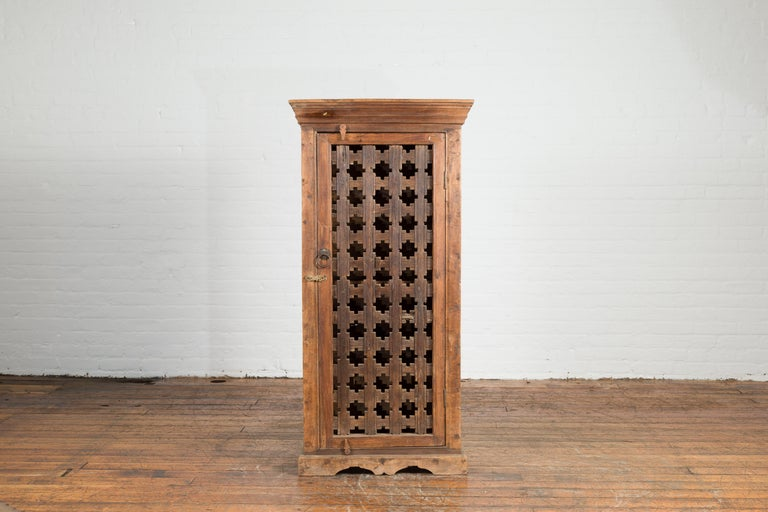 Rustic 19th Century Indian Wooden Cabinet with Single Fretwork Door and Brass Handle For Sale