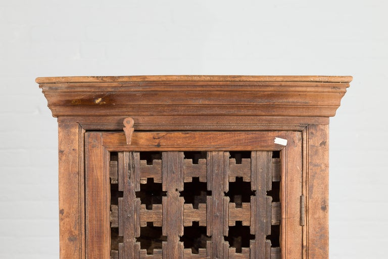 19th Century Indian Wooden Cabinet with Single Fretwork Door and Brass Handle In Good Condition For Sale In Yonkers, NY