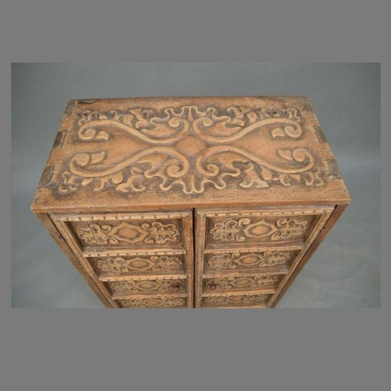 19th Century Indonesian Carved Teak Two Door Cabinet In Good Condition For Sale In Middleburg, VA