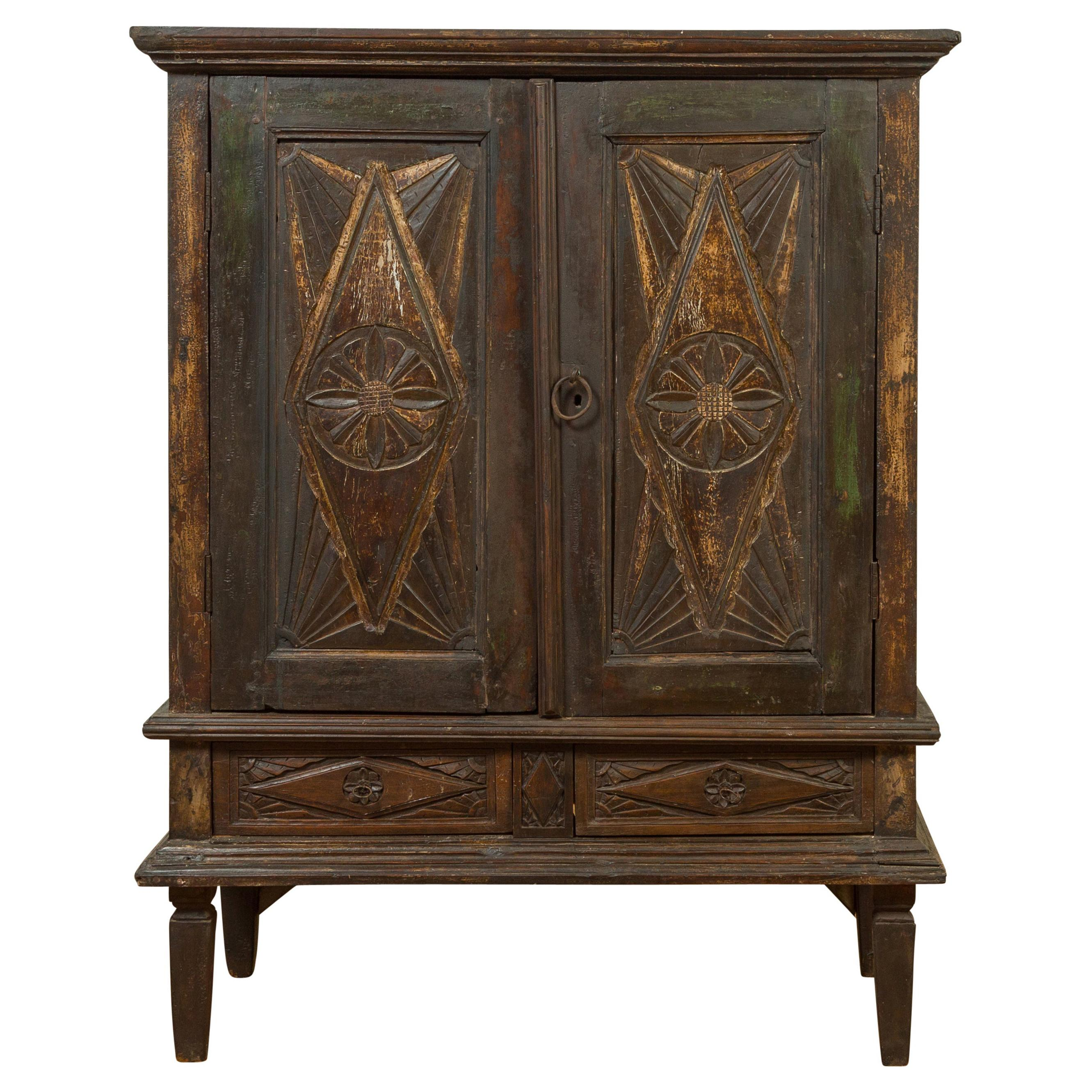 19th Century Indonesian Wooden Cabinet with Doors, Drawers and Carved Medallions