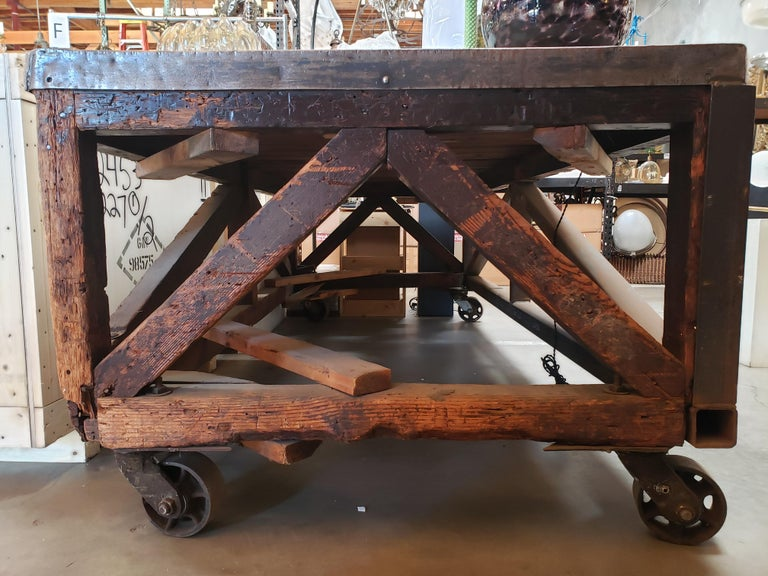 19th Century Industrial Steel Encased Redwood Wheeled Table For Sale 8