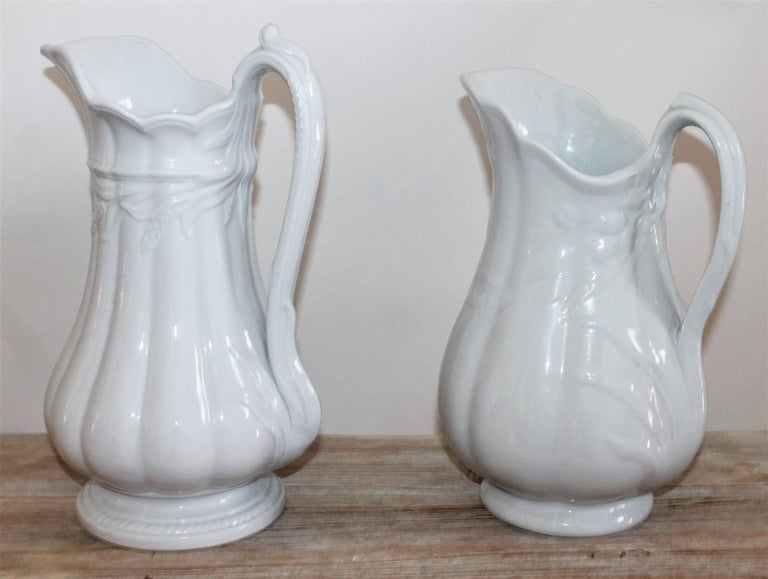 These two wheat pattern ironstone water pitchers are in fantastic pristine condition. Both are slightly different patterns.  Small pitcher measures: 8 x 11 x 6.5 Large pitcher measures: 8 x 12 x 7.