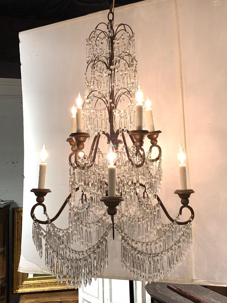 Gorgeous 19th century Italian crystal chandelier with 10 lights and beautiful cascading prisms.
