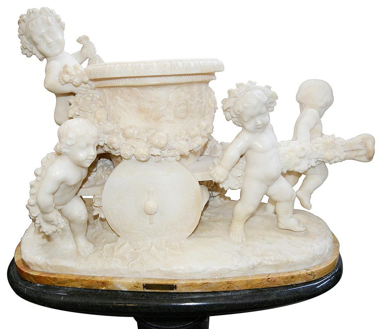 This enchanting 19th century Italian carved Alabaster group of four putti playing whilst pushing and pulling a wooden cart, entitled; 'From the harvest'  By Prof; A. Petrill, Firenze. Raised on a contemporary green marble pedestal fluted pedestal.
