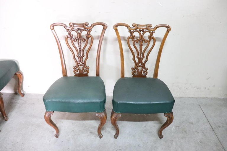Series of eight refined 19th century authentic Italian Art Nouveau walnut wood chairs in the style of Alberto Issel. Refined and rare decoration the back is hand carved with a curls and swirls moved. The legs are very elegant moved. The seat is wide