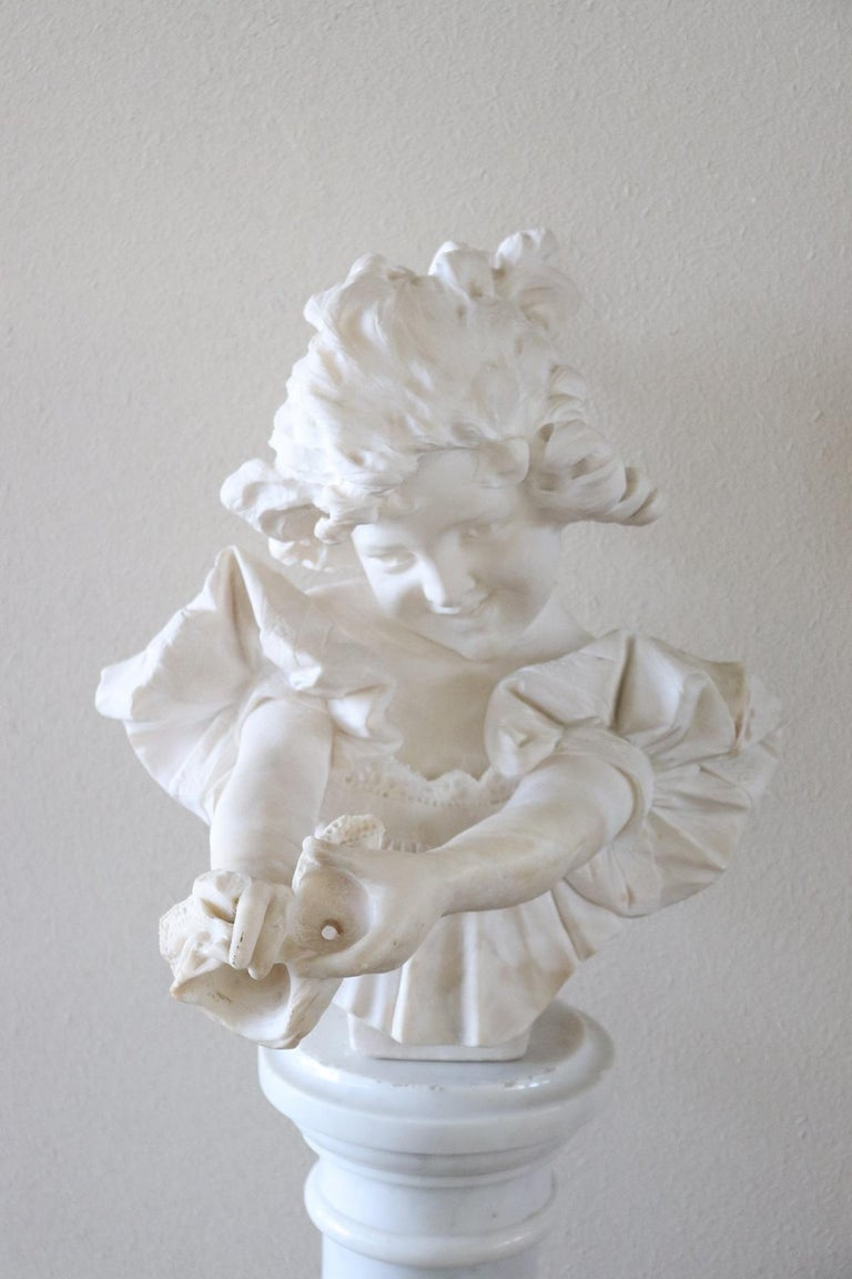 Beautiful bust of a beautiful child in white Carrara marble signed A. Frilli important Italian lorentine sculptor active between the late 1800s and early 1900s. This bust is sculpted with rare precision typical of the best Italian sculptors. The