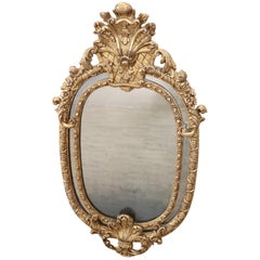 19th Century Italian Baroque Style Carved Gilded Wood Oval Wall Mirror
