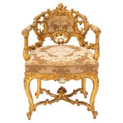 19th Century Italian Carved Giltwood Armchair with Cherub Motif