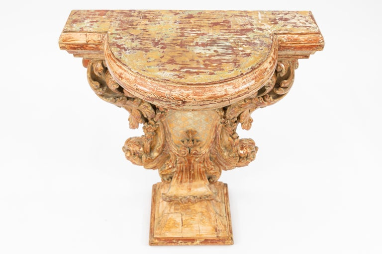 Early 19th century Italian carved giltwood console with garland motif.
