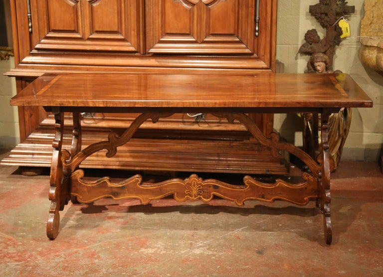 Patinated 19th Century Italian Carved Walnut Trestle Table with Decorative Inlay Motifs For Sale