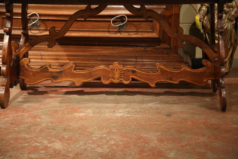 Cherry 19th Century Italian Carved Walnut Trestle Table with Decorative Inlay Motifs For Sale