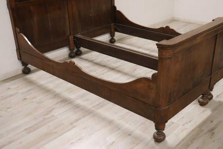 Beautiful antique Italian antique double bed Charles X 1825s. The bed is completely in solid walnut with a beautiful patina. This bed has been restored so it will be delivered in perfect condition ready to be used in your home. Net and mattress are