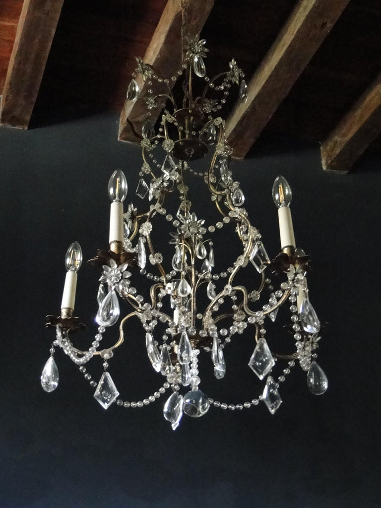 19th century Italian cristal five-light chandelier, with flower-formed beading and gilt metal leaves as candle holders. Very special transparent chandelier.