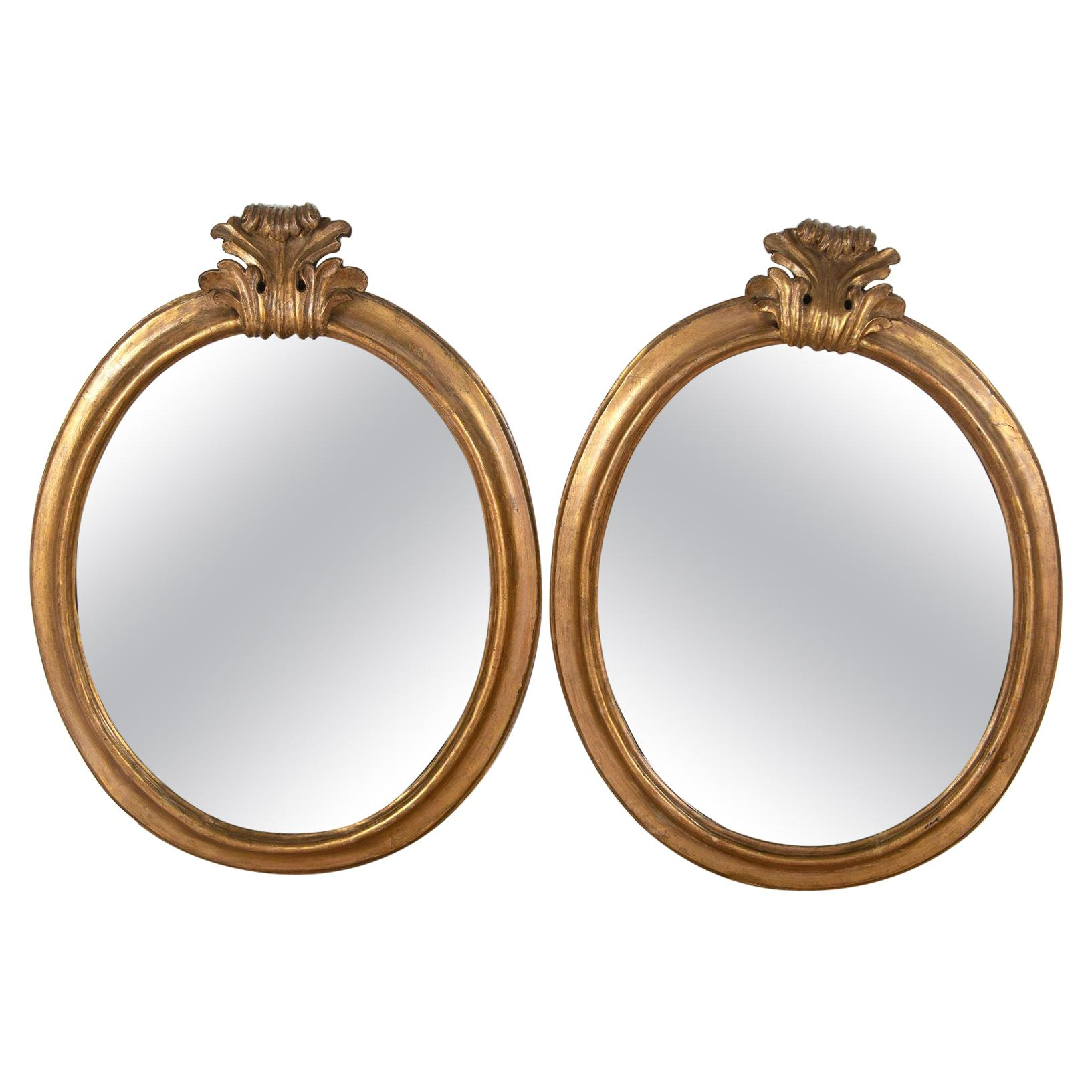 19th Century Italian Gilded Oval Mirrors