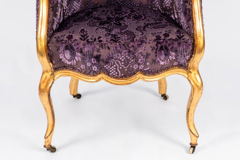 19th century Italian giltwood single armchair with finely carved details. Newly upholstered in bright purple velvet.