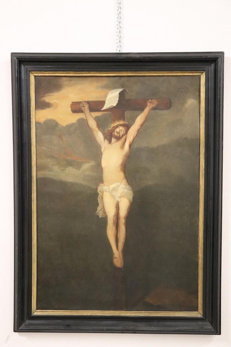 Great oil painting on canvas Crucifixion of Jesus scene. Excellent pictorial quality Jesus is depicted in the cross his face perfectly shows the pain. The body is made with excellent precision. The landscape at the back is very dark to underline