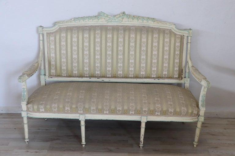 Rare complete Italian luxury Louis XVI style living room set includes: 1 large sofa 2 armchairs 4 chairs Refined living room set in lacquared wood. The living room comes from an important Italian villa and embellished the central hall dedicated