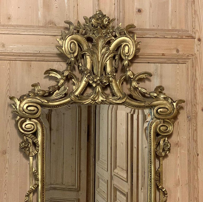 19th century Italian neoclassical carved giltwood mirror combines naturalistic forms in a symmetrical presentation with classic Greco-Romanesque architecture to create a singular effect. As is typical with Italian craftsmanship of this period, it is