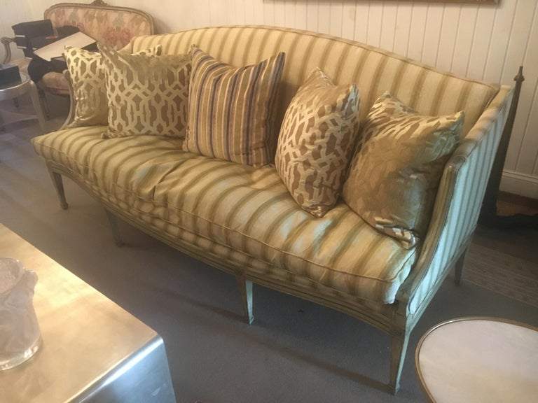 Handsome 19th century Italian neoclassical sofa with painted decoration. Celadon stripped silk upholstery.