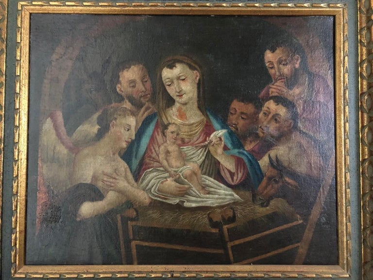 A beautiful 19th century Italian oil on canvas of Jesus, Mary, Wise Men, Angel and Donkey.