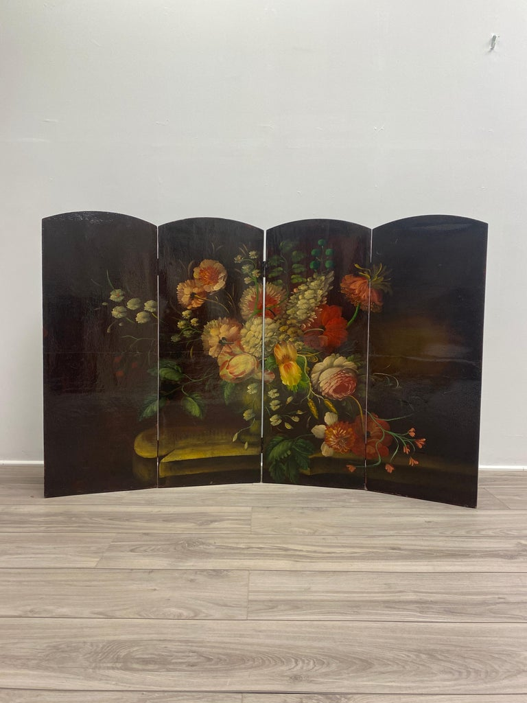 Late 19th century Italian screen with a gorgeous oil painting of floral scene. The oil paint colors are vibrant and in good condition. The frame is made of canvas over a wooden frame with four hinged panels rectangular with arched tops.