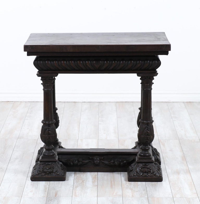 Glorious, 19th century Italian carved walnut center table in the Renaissance style   This rare table consists of a solid rectangular top with a a heavily carved base including detailed columns, depictions of cherubs, animals and floral