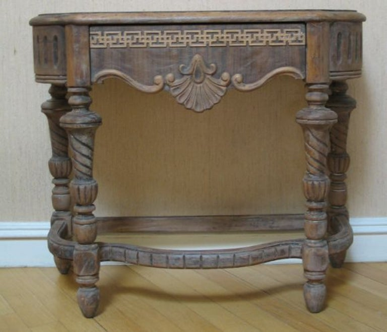 Carved wood table with single drawer.