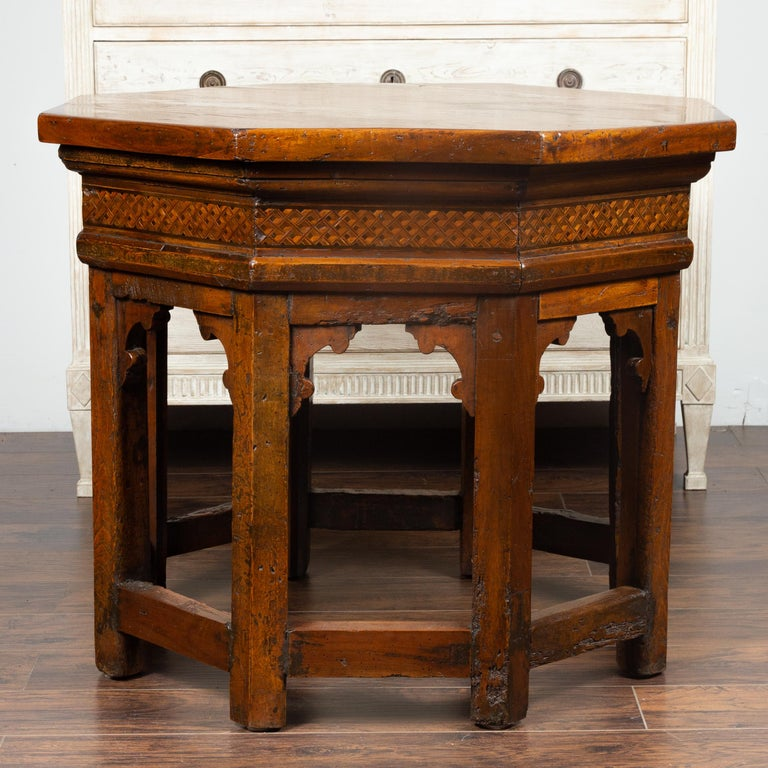 An Italian walnut octagonal center table from the mid-19th century (or earlier), with geometrical inlay. We have a near pair available with slight variations in the dimensions, please check item LU836716746041. Born in Italy during the 19th century,