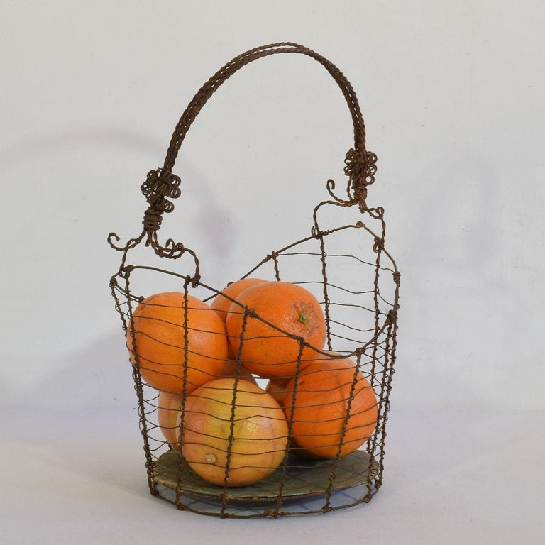Wonderful and very rare wirework basket with a great form. Iron and zinc, Italy, circa 1850-1900 Weathered.