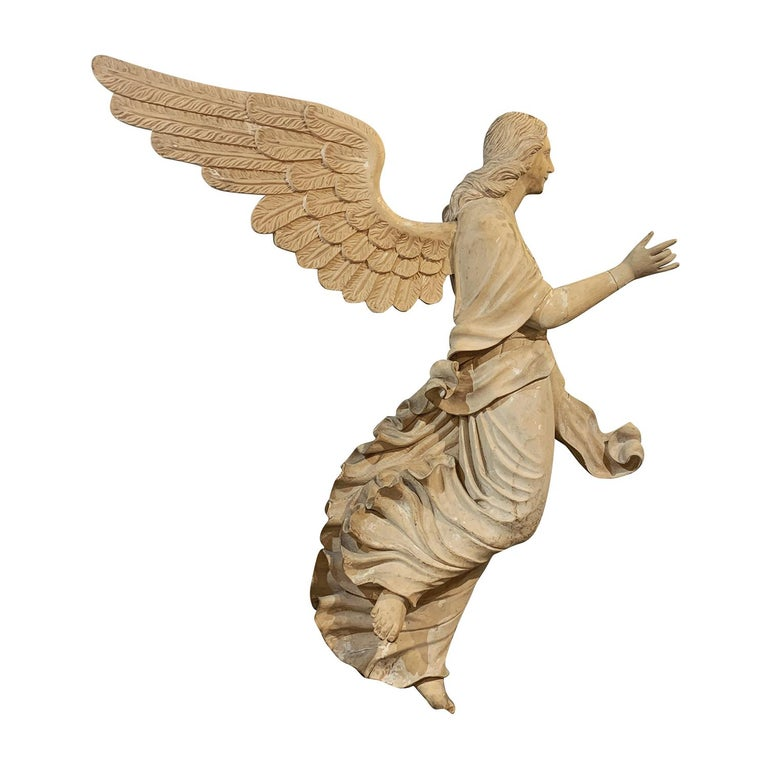 An antique Italian pair of early 19th century half ?relief wooden angels made of hand carved Basswood, enhanced by unique wood carvings, in good condition. Wear consistent with age and use. Minor damages due to age, circa 1810-1830, South Tyrol,