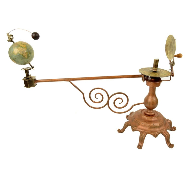 Antique brass orrery made for the German market by Jan Felkl Prag in the second half of the nineteenth century. Cast iron base, papier mâché´ globe, with detailed territorial map and oceanic currents. Very good condition. Measures: Length 75 cm -