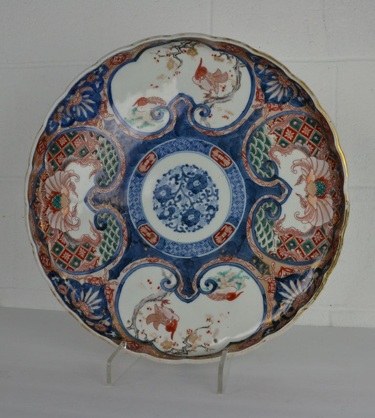 A large Japanese 4 color platter. Late 19th century with character marks. White ground panels decorated with birds. Vertical