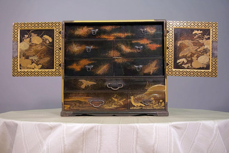 19th century Japanese lacquer miniature cabinet, with brass and gold.
