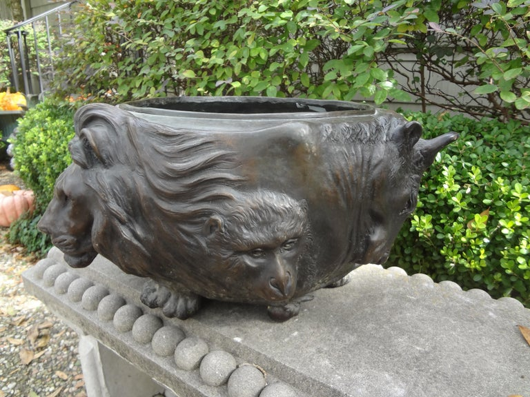 Outstanding large 19th century Japanese Meiji period (1868-1912) bronze jardinière. This stunning heavy weight (about 35 lbs) jardinière or planter depicts a variety of animal heads in relief. It is signed on the bottom. See photos of signature.
