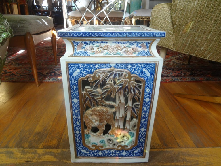 Stunning 19th century Japanese Meiji period hand decorated porcelain garden seat, garden stool or table. This antique Japanese garden seat is beautifully detailed with lion and crane motif and Greek key design trimmed in gilt. This would make a