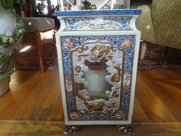 Stunning 19th century Japanese Meiji period hand decorated porcelain garden seat, garden stool or table. This antique Japanese garden seat is beautifully detailed with gilt trimmed feet and Greek key accents. This would make a perfect side table.