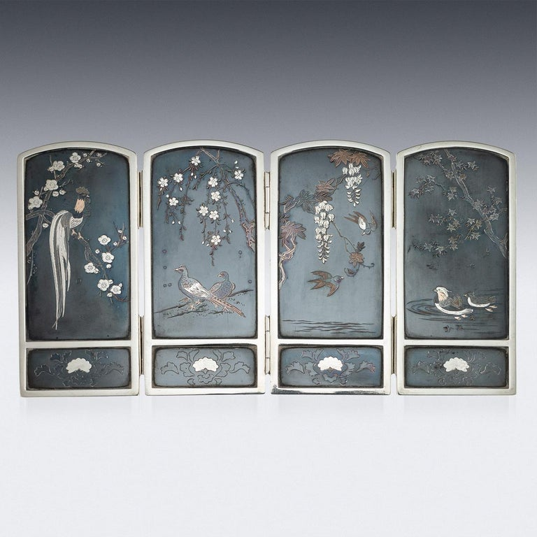 Antique late 19th century Japanese Meiji period very fine solid silver and shibuichi table folding screen, both sides decorated with birds amongst prunes, cherry blossom and wisteria with two colour gold on niello ground. The piece dates to the