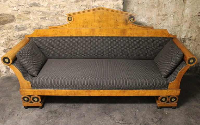 19th century Karl Johan Biedermeir sofa with upholstered seat in the empire form with bronze roundel mounts, bolstered sides and legs.
