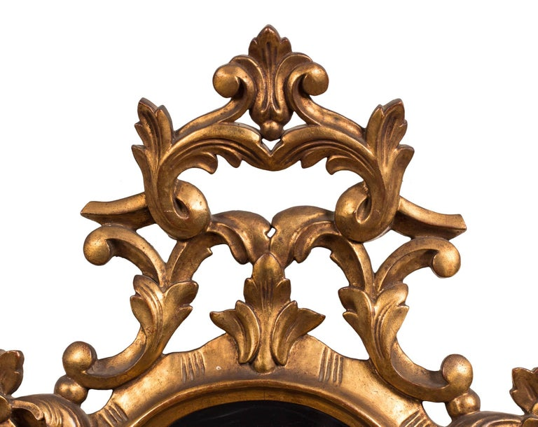 Originally made to be used with candles, this 19th century Spanish carved giltwood sconce has been electrified, and has two sockets for use with candelabra style bulbs. The etched mirror by La Granja features the figure of a classically dressed