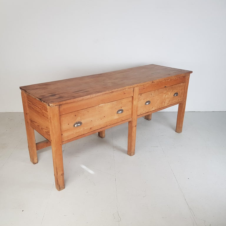 Lovely 19th century pine baker's table. With very useful storage drawers.