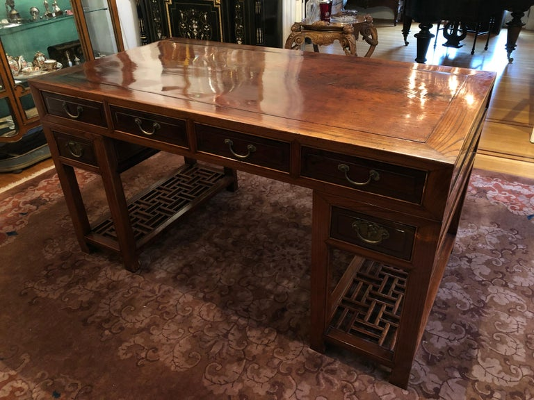 Handsome and large Chinese dark elm wood desk. Deep drawers that run the depth of the desk 
