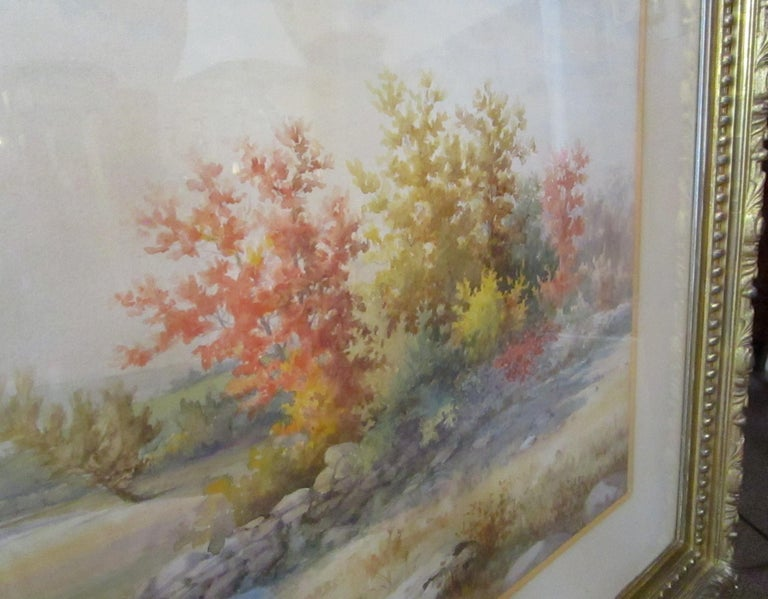Large sized exquisitely executed autumn landscape watercolor by American painter Francis Wheaton 1849-1942. (Signed Francis Wheaton 1890 New York.) It is handsomely matted and framed in the original period carved giltwood frame. The watercolor