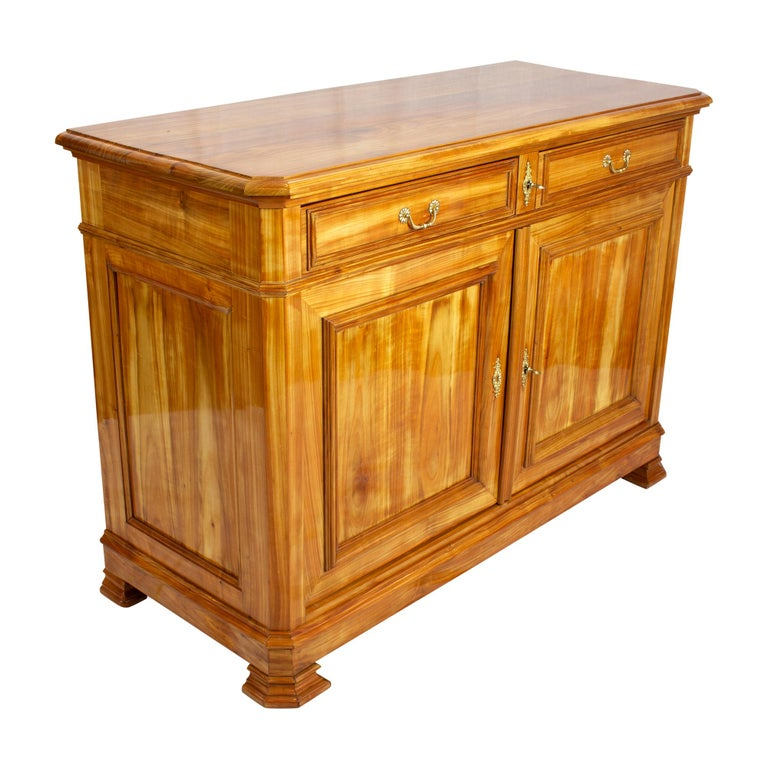 The sideboard originates from Switzerland in the late Biedermeier period around 1850 (transition to historicism). The furniture was made of solid cherrywood. The backside is made of spruce. It can be assumed that it is wild cherry, as the mass is