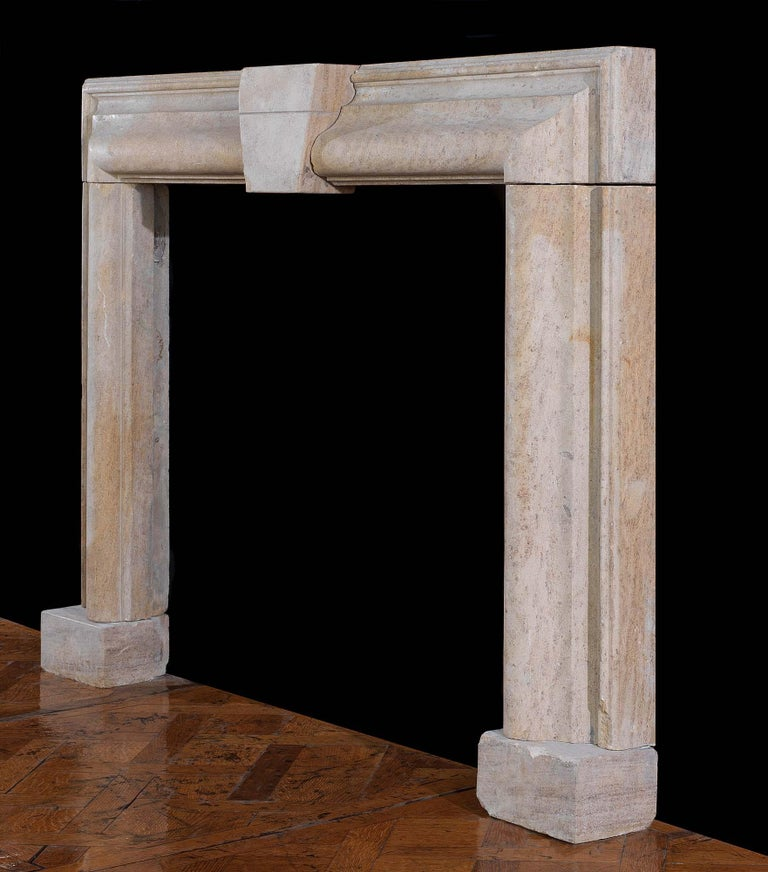 A substantial Bolection chimneypiece carved from beautiful soft grey, salmon brown and taupe Derbyshire Fossil Limestone with a large central keystone. This stone is quite hard and will take a polish. English, circa 1860.  Notes: Derbyshire Fossil
