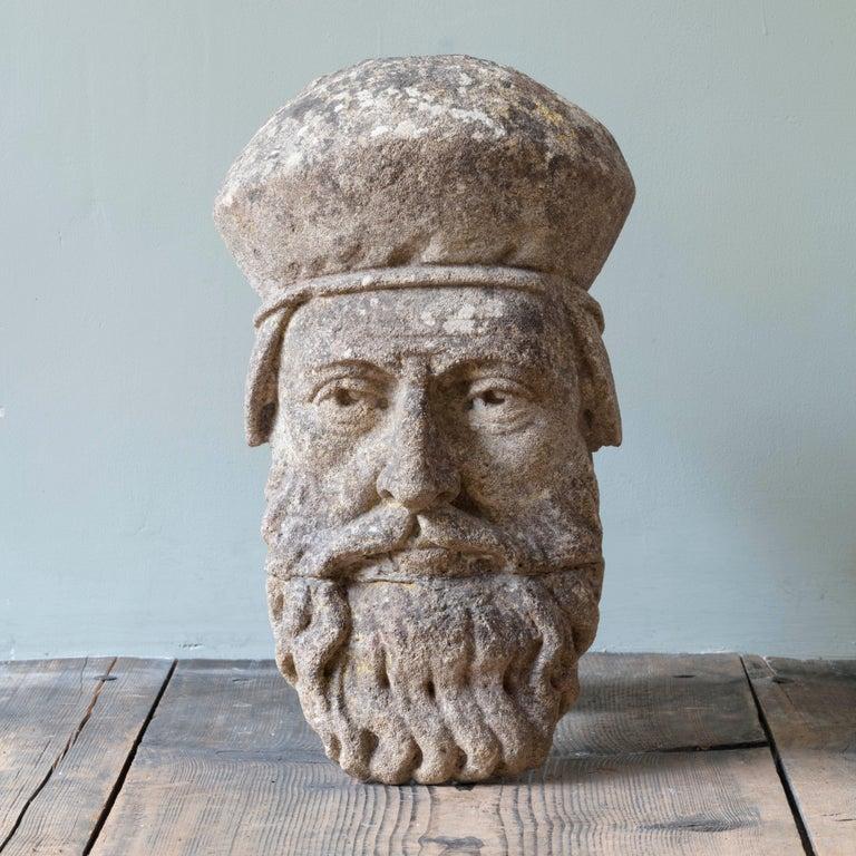 19th century limestone head sculpture.