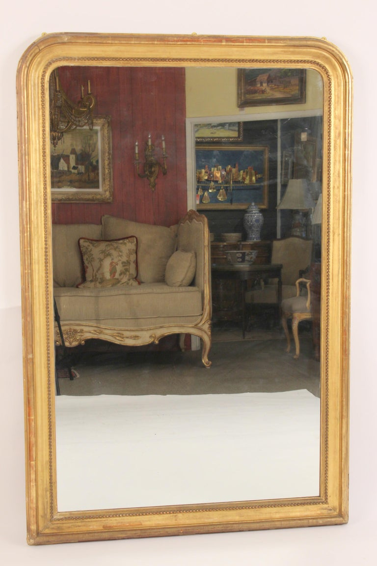 Antique Louis Philippe style giltwood mirror, late 19th century.