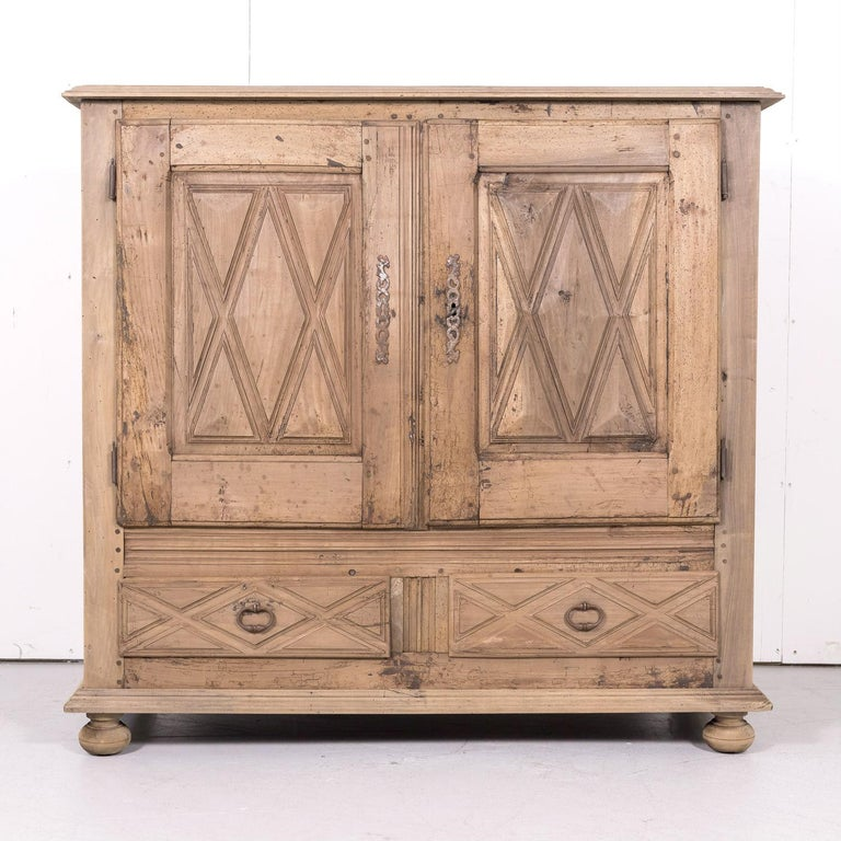 19th century Louis XIII style bleached walnut buffet d'appui handcrafted by talented artisans in the French Basque Country, circa 1870s. This handsome buffet features two doors with raised diamante point decoration that open to reveal a single shelf