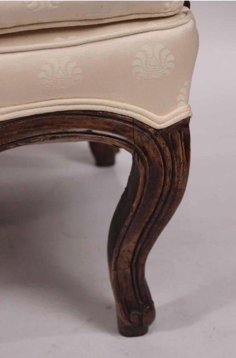 Late 19th century Louis XV style walnut serpentine sofa with carved flowers.