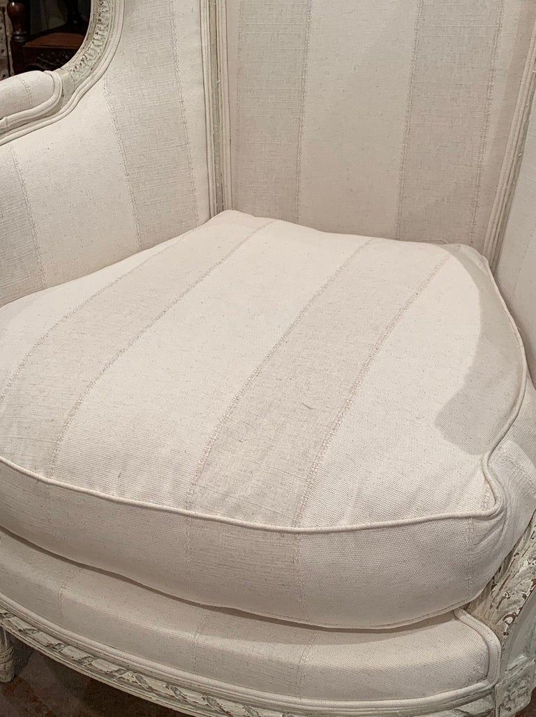 Cotton 19th Century Louis XVI Carved Painted Bergère Armchair with Striped Fabric For Sale