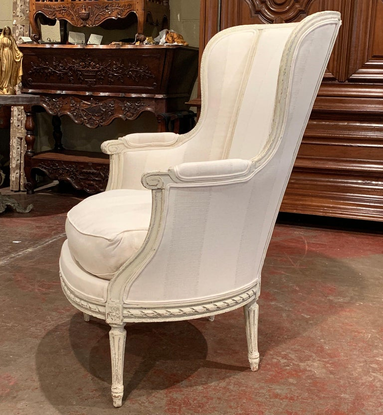 19th Century Louis XVI Carved Painted Bergère Armchair with Striped Fabric For Sale 2